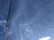 Odd rainbow seen directly overhead (instead of on the horizon).