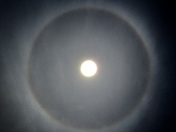 The sky has thin veil of cloud and it showed sun halo over Folsom
