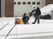 Panda using snow blower at 1st Avenue Collision in Red Lion.