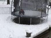 Robert enjoying the snow on his trampoline, in Glen Burnie