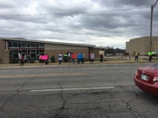 Let Flores County teachers protesting outside Patrick Lynch Public Library