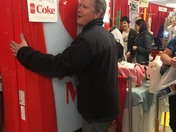 Jay from Hampstead enjoying a hug from the Coke Hug machine at Made in NH Expo