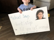 Here is my youngest holding my sign for me before we left.