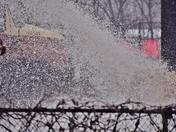 April 15th.Spring cancelled. Snowplow trucker sprays snow.