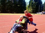 CJ Pace and Faith James flying over the finish line at Special Olympics