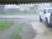 Standing on my front porch videoing rain when lightning came through the awning