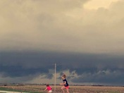 My girls getting in some trampoline time before the downpour, east of Osceola, IA