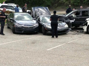 The scene of a 4 car crash at Walnut Place plaza on Brown's Hill Road