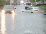 2 cars caught in a flash flood on Vale St in everett Massachusetts