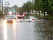 2 cars stuck in flash flood yesterday on Vassel St in Everett