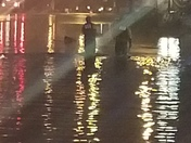 Police walking through flood on 51 in carrick