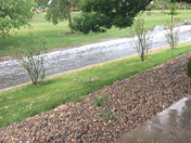 Flash flooding this afternoon concrete arroyo drainage at Academy Hills Park. Kfinch