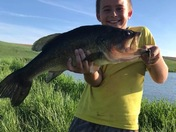 Corbin was so happy to catch this 23 1/2 inch large mouth bass all by himself!