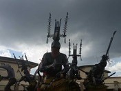 Native American statues with a stormy background