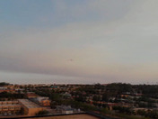 AREIAL VIEW OF ABQ'S SMOKY SUNSET 150 FEET ALTITUDE.