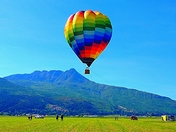 Colourful hot air balloon on a hot day
