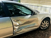 Vehicle was hit while parked in driveway at Harbor Pines Mobile Home Park