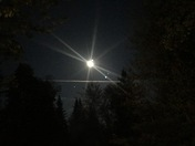 Moon with jet trail