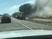Car crash and car on fire between davis and dixon.