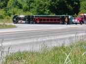 Overturned tracker trailer on 81
