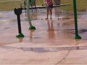 Lady at Moore splash park washing out poop in the water kids are playing in.