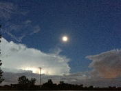 Storm headed East with a full moon shining