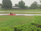 Yesterday our yard was flooded due to the tremendous amount of rain and my husband went out on a kayak!