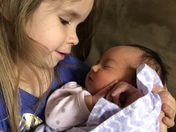 This is Elia (3) holding her brand new cousin Kylia.