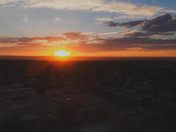 ( DRONE AERIAL VIEW ) CARRIBEAN SUNSET OVER ALBUQUERQUE NM ( 4K VIDEO )