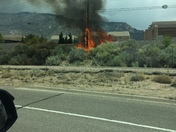 The power line pole was on fire near Paseo del Norte and Tramway Blvd.