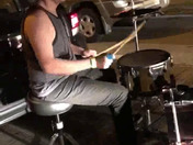 Kid, stuck in traffic jam on Rt 28 last night,pulls out his drums to entertain others!