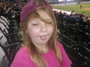 Abby enjoying a baseball game on a rainy day