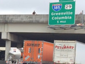 Still shot from video from I85 underneath Whitehorse Rd Bridge where man attempted to jump.