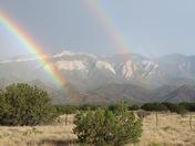 Sandias through a double rainbow