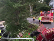 Antique fire truck traveling north in west shore road looses control