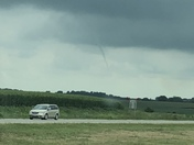 Small tornado coming down from the clouds but did not touch the ground