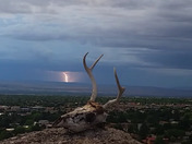 Buck skull with lightning in the background