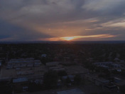 AERIAL DRONE VIEW OF ANOTHER STUNNING SUNSET OVER SE ABQ