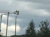 Two electricians in the bucket watching the tornado heading to bondurant