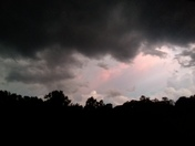 Taken about 9:15 pm just on the edge of the storm over the tree tops in our backyard