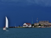 Sailing on verge of a thunder storm.