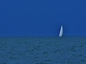Sailboat in a thunderstorm sky.