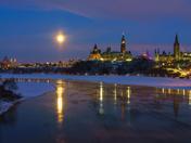 Ottawa skyline in winter under full moon