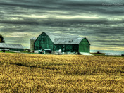 The Green Barn with storm clouds