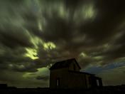 Aurora Bursting Through the Clouds
