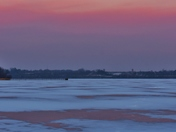 Amazing evening sky colors frozen lake.