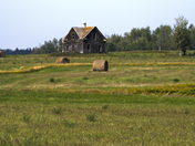 Panorama with an abandoned farmhouse.