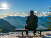 Man sitting alone, looking at the view