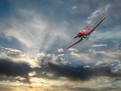Red pkane blue sky