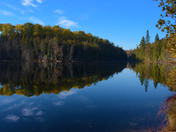 remote lake/pond found in the forest in the fall